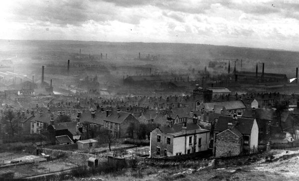 View over Wincobank and Brightside from (right) Jenkin Road showing (right) St. Margaret's C.of E. Church, Brightside and (background) English Steel Corporation's River Don Works, Brightside Lane. From an original at Sheffield Local Studies library