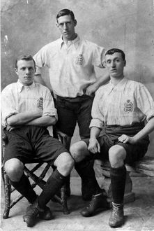 Three footballers in England shirts. The player on the right is Albert Sturgess who
